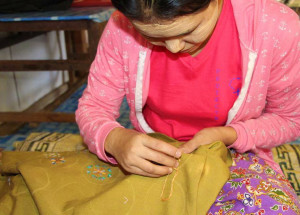 Karenni refugee woman embroiderer